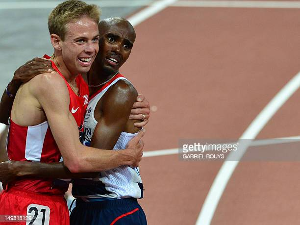 Britain's Mohamed Farah celebrates with second-placed US' Galen Rupp after winning the men's 10,000m final at the athletics event of the London 2012...