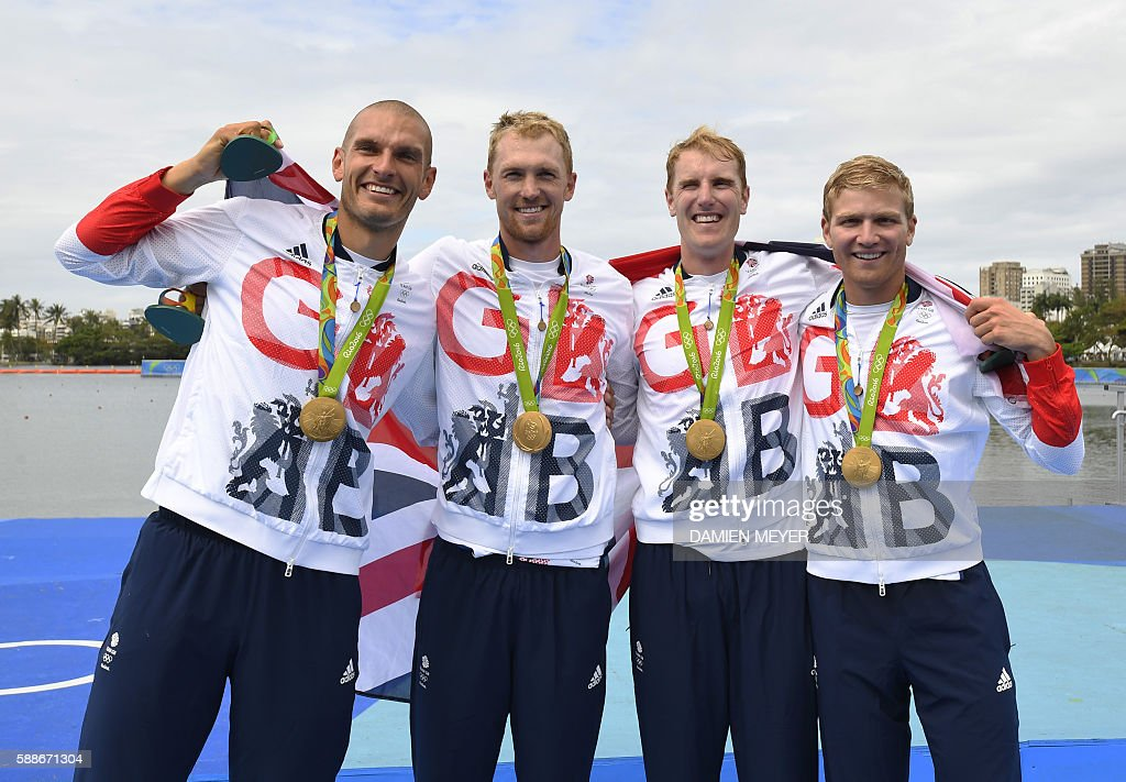 Britain's Mohamed Sbihi, Alex Gregory, Constantine Louloudis and George Nash pose with their gold medals on the podium of the Men's Four final rowing competition at the Lagoa stadium during the Rio 2016 Olympic Games in Rio de Janeiro on August 12, 2016. / AFP / Damien MEYER