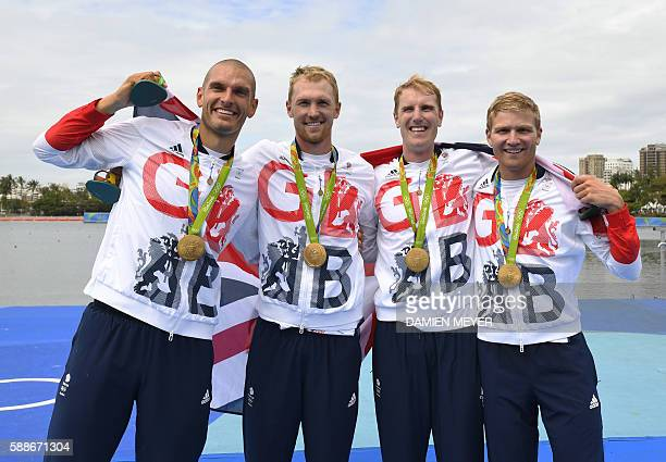 Britain's Mohamed Sbihi Alex Gregory Constantine Louloudis and George Nash pose with their gold medals on the podium of the Men's Four final rowing...