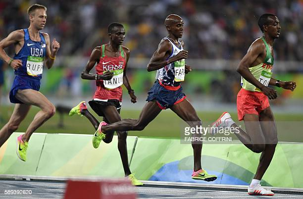 Britain's Mohammed Farah Kenya's Paul Kipngetich Tanui Ethiopia's Tamirat Tola and USA's Galen Rupp compete in the Men's 10000m during the athletics...