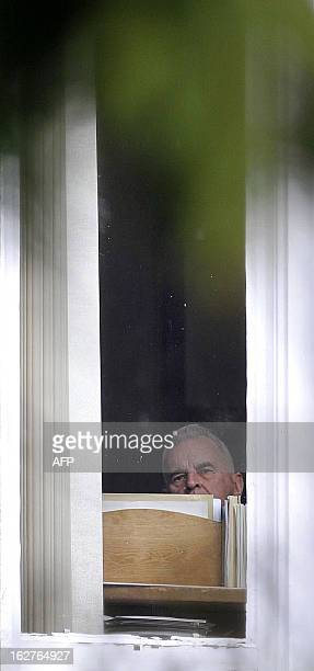 Britain's most senior Roman Catholic cleric Cardinal Keith O'Brien looks out of a window at his home in Edinburgh, Scotland, on February 26, 2013....