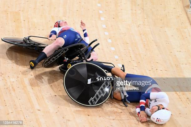 Britain's Neah Evans and Britain's Katie Archibald crashes after setting world record in the first round heats of the women's track cycling team...