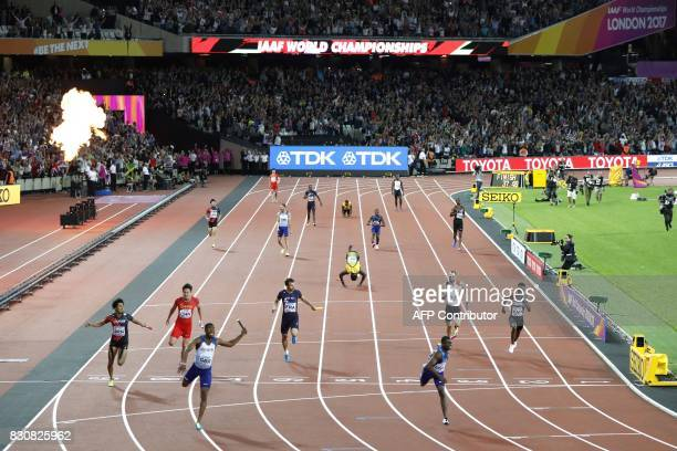 Britain's Nethaneel MitchellBlake crosses the finish line first ahead of US athlete Christian Coleman in second place and Japan's Kenji Fujimitsu as...