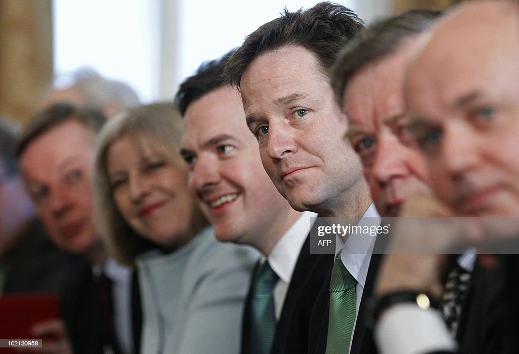 Britain's new Liberal Democrat Deputy Prime Minister, Nick Clegg (3rd R), listens as he attends the first Cabinet meeting of the new Conservative/Liberal Democrat coalition Government, with Conservative Party colleages Education Secretary, Michael Gove (L), Home Secretary, Theresa May (2nd L), Chancellor of the Exchequer, George Osborne (C), Justice Secretary, Ken Clarke (2nd R) and Work and Pensions Secretary, Iain Duncan Smith, in 10 Downing Street, central London on May 13, 2010. Britain's new premier David Cameron chaired his first cabinet meeting Thursday, bringing together former rivals from the Conservative and Liberal Democrat parties in a historic coalition. Deputy premier Nick Clegg and four other Lib Dem ministers gathered with their new Tory colleagues in Downing Street, in the first test of whether their promise of a 'new politics' in Britain can work in practice. AFP PHOTO/Andrew Winning/Pool
