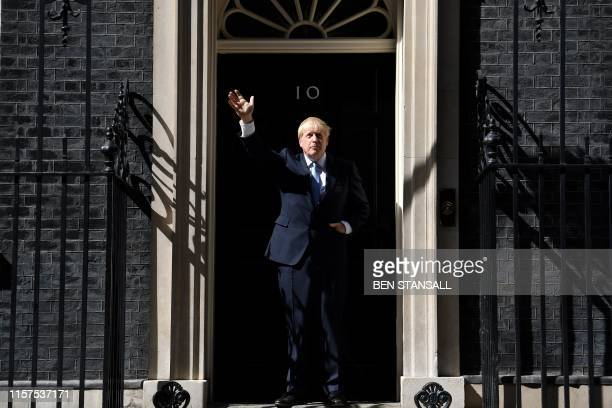 Britain's new Prime Minister Boris Johnson gestures after giving a speech outside 10 Downing Street in London on July 24, 2019 on the day he was...