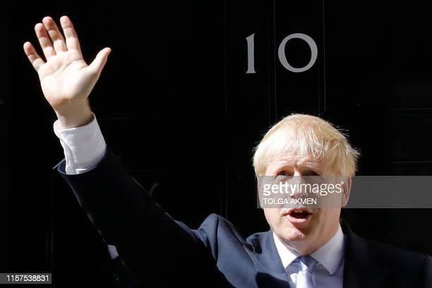 Britain's new Prime Minister Boris Johnson waves after giving a speech outside 10 Downing Street in London on July 24, 2019 on the day he was...