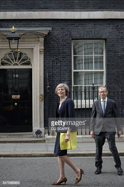 Britain's new Prime Minister Theresa May and her husband Philip John arrive back in Downing Street in central London on July 13 2016 on the day she...