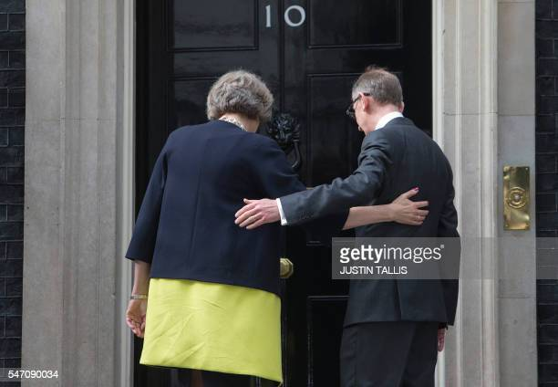 Britain's new Prime Minister Theresa May and her husband Philip John walk towards 10 Downing Street in central London on July 13 2016 on the day she...