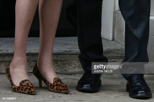 Britain's new Prime Minister Theresa May's Leopardprint shoes are pictured outside the door of 10 Downing Street beside her husband Philip John in...