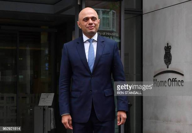 Britain's newly appointed Home Secretary Sajid Javid poses for a photograph after exiting the Home Office in central London on April 30 2018 Sajid...