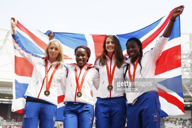 Britain's Nicola Sanders Marilyn Okoro Kelly Sotherton and Christine Ohuruogu pose on the podium after being reallocated a bronze medal for the...
