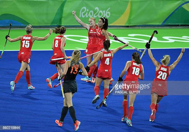 Britain's Nicola White celebrates with teammate Britain's Sam Quek after scoring a goal during the women's Gold medal hockey Netherlands vs Britain...