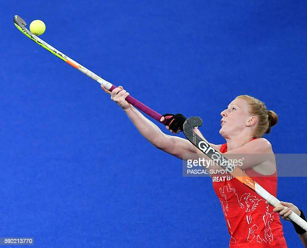 TOPSHOT Britain's Nicola White hits the ball during the women's Gold medal hockey Netherlands vs Britain match of the Rio 2016 Olympics Games at the...
