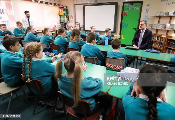 Britain's Northern Ireland Secretary Julian Smith talks with school children during his visit to Maghaberry Primary School in Moira, near Belfast,...
