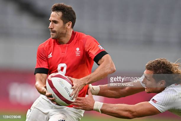 Britain's Ollie Lindsay-Hague is tackled by USA's Joe Schroeder in the men's quarter-final rugby sevens match between Britain and the US during the...