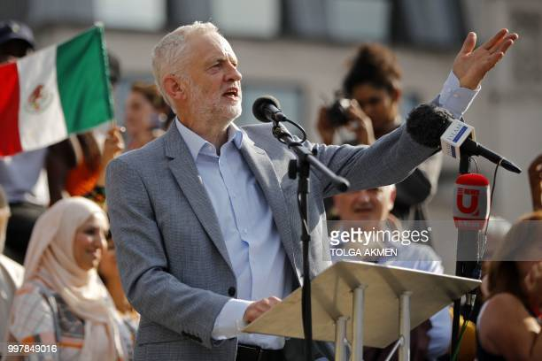 Britain's opposition Labour Party leader Jeremy Corbyn addresses the crowd in Trafalgar Square as protesters against the UK visit of US President...
