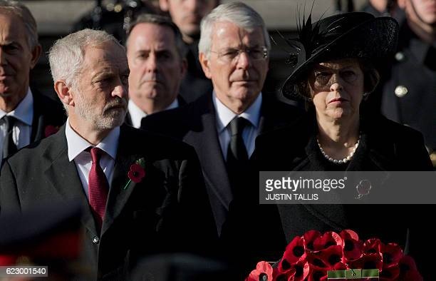Britain's opposition Labour Party Leader Jeremy Corbyn and British Prime Minister Theresa May take part in the Remembrance Sunday ceremony at the...