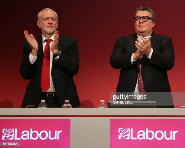 Britain's opposition Labour party leader Jeremy Corbyn and deputy leader Tom Watson take part in the first day of the Labour Party Conference in...