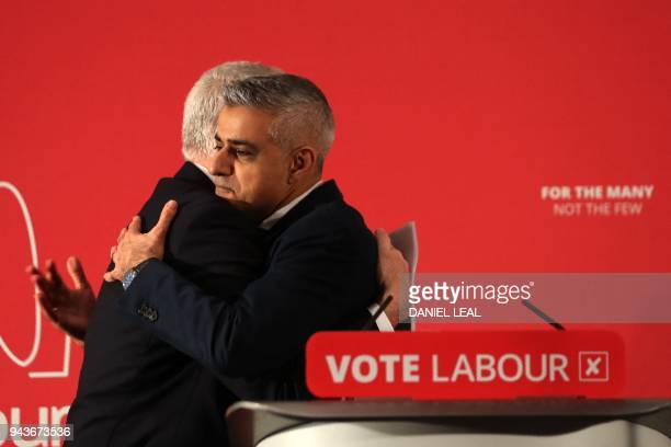 Britain's opposition Labour party leader Jeremy Corbyn and The Mayor of London, Sadiq Khan embrace during the launch of Labours local election...