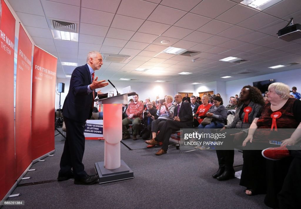 Britain's opposition Labour Party Leader Jeremy Corbyn delivers a speech to supporters at Peterborough Football Club in Peterborough, central England on May 19, 2017, as campaigning continues in the build up to the general election on June 8. / AFP PHOTO / Lindsey Parnaby