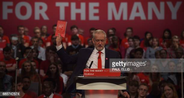 Britain's opposition Labour party Leader Jeremy Corbyn delivers a speech to supporters at the International Convention Centre in Birmingham central...