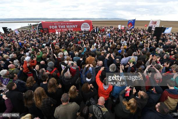 Britain's opposition Labour party Leader Jeremy Corbyn delivers a speech to party supporters on the beach in West Kirby west of Liverpool in north...