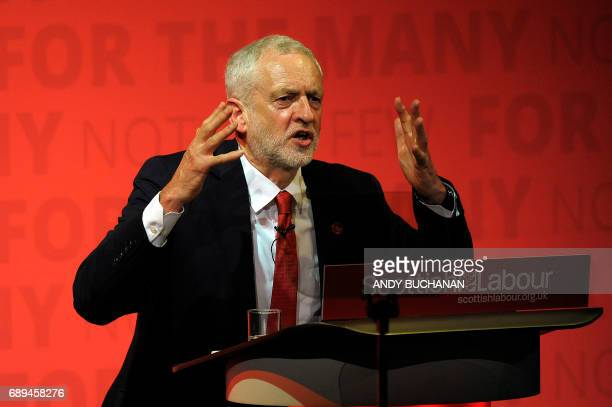 Britain's opposition Labour party Leader Jeremy Corbyn delivers a speech to supporters at a party rally in Glasgow Scotland on May 28 as campaigning...