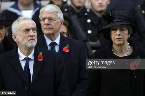 Britain's opposition Labour Party Leader Jeremy Corbyn former British prime minister John Major and British prime minister Theresa May attend the...