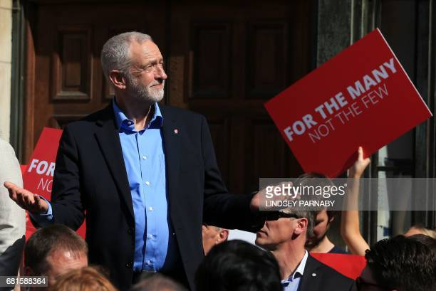 Britain's opposition Labour party Leader Jeremy Corbyn gestures after speaking to supporters at a general election campaign visit in York northern...