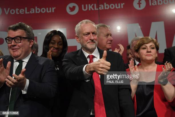 Britain's opposition Labour party Leader Jeremy Corbyn gives a 'thumbs up' sign as he stands with Britain's opposition Labour party's Deputy Leader...