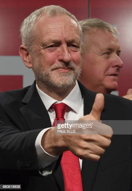 Britain's opposition Labour party Leader Jeremy Corbyn gives a 'thumbs up' sign following his general election campaign launch in Manchester...