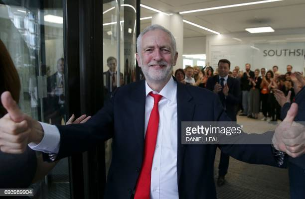 Britain's opposition Labour party Leader Jeremy Corbyn gives a thumbs up as he arrives at Labour Party headquarters in central London on June 9 2017...