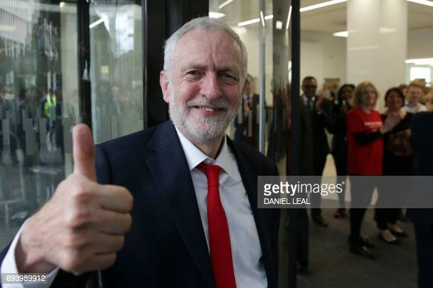 TOPSHOT Britain's opposition Labour party Leader Jeremy Corbyn gives a thumbs up as he arrives at Labour Party headquarters in central London on June...