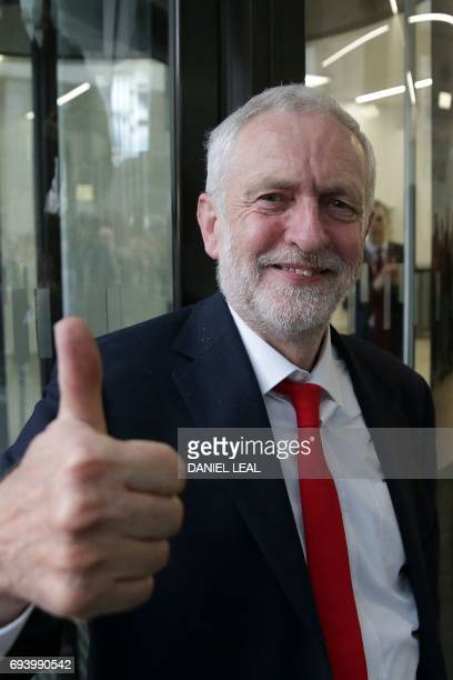 Britain's opposition Labour party Leader Jeremy Corbyn gives a tumbs up as he arrives at Labour Party headquarters in central London on June 9 2017...