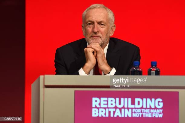 Britain's opposition Labour Party leader Jeremy Corbyn listens to a speech at the Labour Party Conference in Liverpool north west England on...