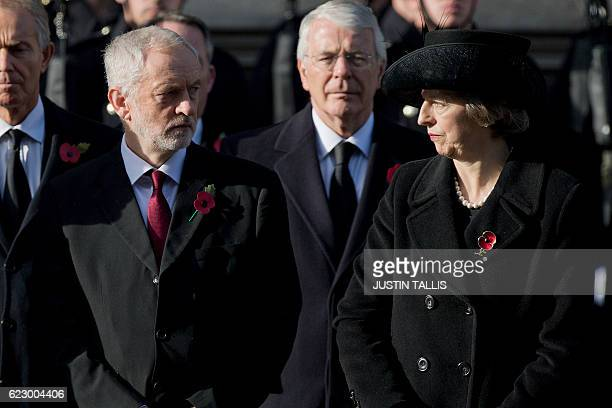 Britain's opposition Labour Party Leader Jeremy Corbyn looks at British Prime Minister Theresa May during the Remembrance Sunday ceremony at the...