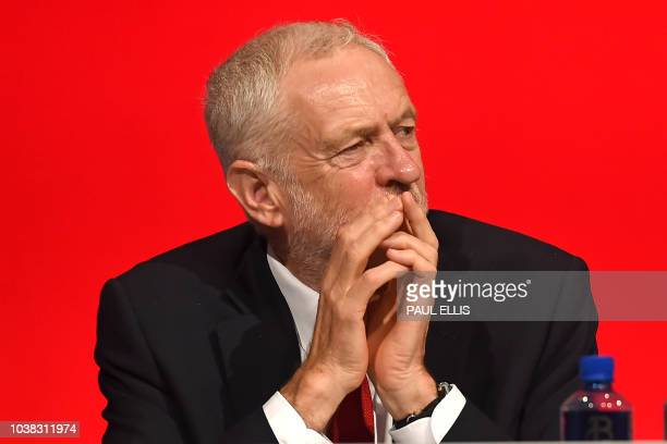 Britain's opposition Labour Party leader Jeremy Corbyn on stage at the Labour Party Conference in Liverpool north west England on September 23 the...