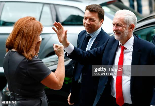 Britain's opposition Labour party Leader Jeremy Corbyn reacts as he is greeted by Karie Murphy a member of his campaign team as he arrives at Labour...