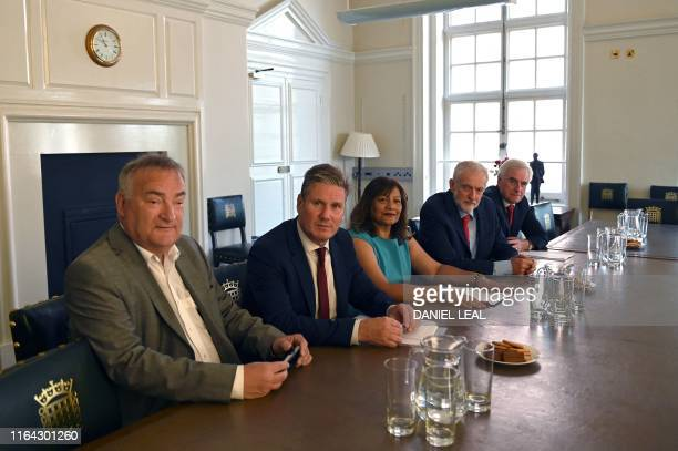 Britain's opposition Labour Party leader Jeremy Corbyn sits with members of his shadow cabinet shadow Chief Whip Nick Brown shadoe Brexit minister...