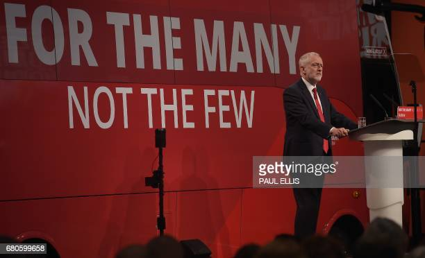 Britain's opposition Labour party Leader Jeremy Corbyn stands in front of his party's campaign bus as he speaks during his general election campaign...