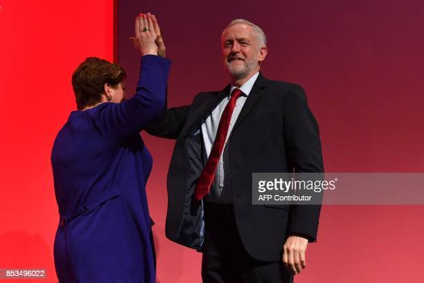 Britain's opposition Labour party leader Jeremy Corbyn successfully highfives Opposition Labour Party Shadow Foreign Secretary Emily Thornberry after...
