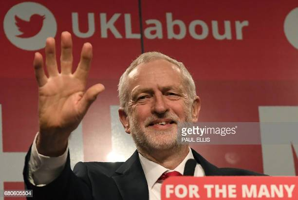 Britain's opposition Labour party Leader Jeremy Corbyn waves after speaking during his general election campaign launch in Manchester northwest...