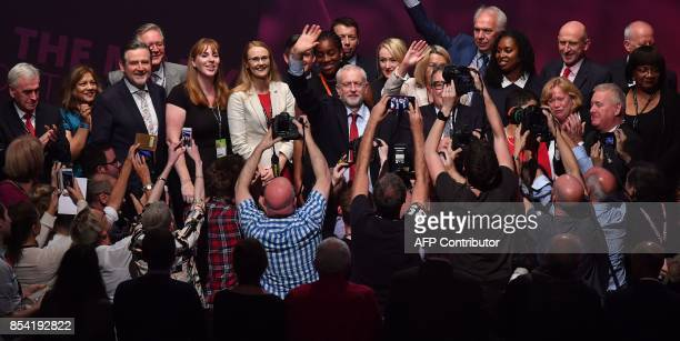 Britain's opposition Labour party Leader Jeremy Corbyn waves as he stands with members of his shadow cabinet after Britain's opposition Labour...