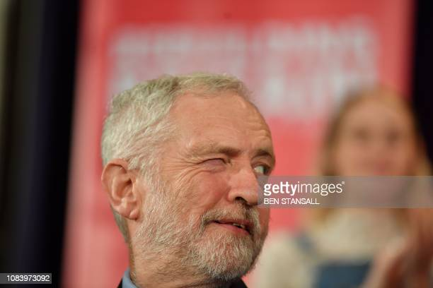 TOPSHOT Britain's opposition Labour party leader Jeremy Corbyn winks to a colleague as he attends a political rally event in Hastings southeast...
