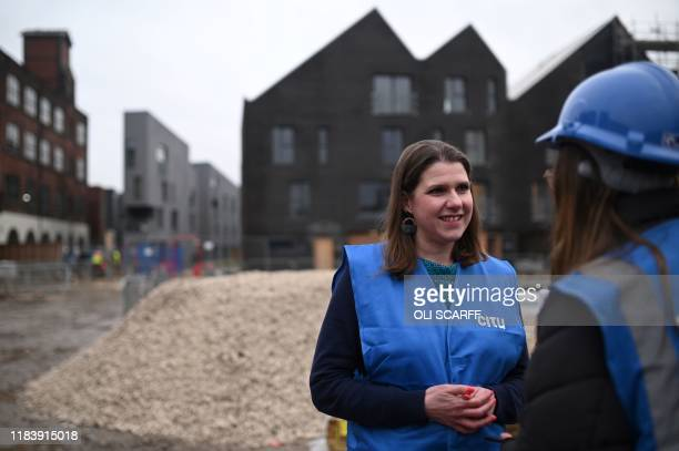 Britain's opposition Liberal Democrats leader Jo Swinson gestures during a general election campaign visit to an eco home building site in Sheffield,...
