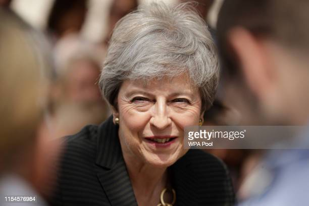 Britain's outgoing Prime Minister Theresa May meets military service personnel and their families at headquarters of Joint Forces Command on July 8,...