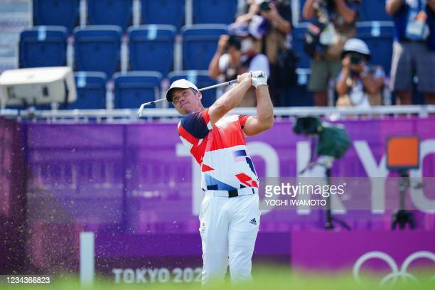Britain's Paul Casey watches his drive from the 10th tee in round 4 of the mens golf individual stroke play during the Tokyo 2020 Olympic Games at...