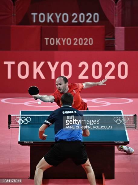 Britain's Paul Drinkhall competes with Austria's Robert Gardos during their men's singles round 2 table tennis match at the Tokyo Metropolitan...
