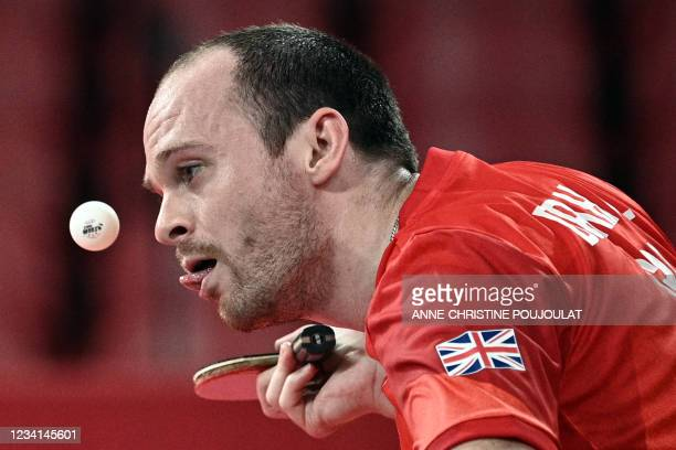 Britain's Paul Drinkhall eyes the ball as he serves to Iran's Nima Alamian during their men's singles round 1 table tennis match at the Tokyo...