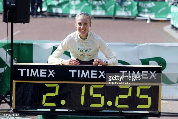 Britain's Paula Radcliffe poses with a display of her time outside Buckingham Palace after breaking the Women's world record for the London Marathon...